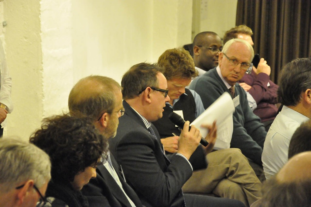 Delegates put questions to the panel during the evening's discussion