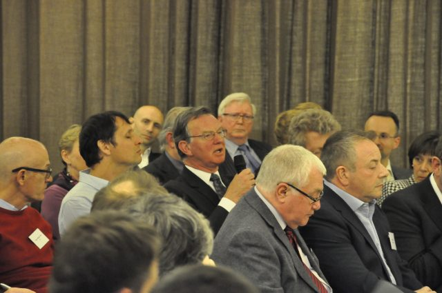 Delegates engage in a lively discussion